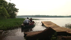 Beaverdam Lake - Canoe launch - Father and 2 Sons Stock Footage