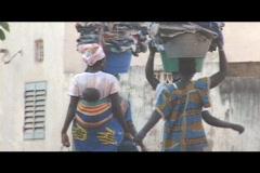 Malian women carrying laundry1 Stock Footage