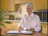 Stock Video Footage of Woman does paperwork at home