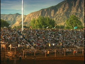 Stock Video Footage of Rodeo Crowd Mountains