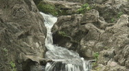 Stock Video Footage of Panning shot of a water stream falling down the rocks