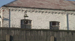 Stock Video Footage of Close-up panoramic shot of a razor-wired fence of Central Jail in Riga
