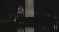Stock Video Footage of NIGHT Monument plus Capitol zoomed