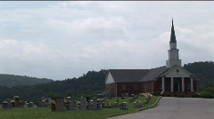Church with cemetary - zoom out Stock Footage