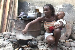 Sao Tome, Africa: Woman cooks over open fire Stock Footage