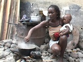 Stock Video Footage of Sao Tome, Africa: Woman cooks over open fire
