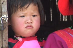 Ethnic minority child looks out of doorway Stock Footage