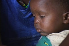 African baby, in Sao Tome, looks at camera Stock Footage