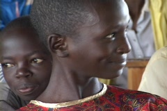 Young girl in Rwanda, happy with her new school, smiles for Camera - stock footage
