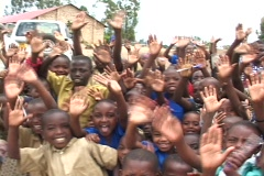 Happy with their new school, students in Rwanda, Africa, wave to Camera - stock footage