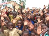 Happy with their new school, students in Rwanda, Africa, wave to Camera Stock Footage