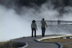 Visiting a Geyser in Yellowstone National Park, Wyoming, United States Stock Footage