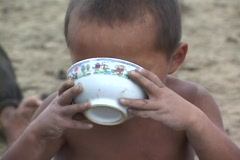 Mongolia: Boy drinks milk from a bowl - stock footage