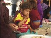 Jordan: Bedouin Child eats. Stock Footage
