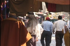 Amman, Jordan: People walk along the streets of Amman, Jordan Stock Footage