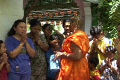 Cambodia: Buddhist monk blesses people with water ritual Stock Footage