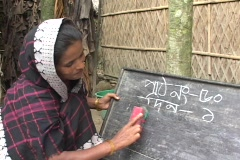 Bangladesh: Woman learns to write in an adult literacy program Stock Footage