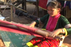 Thailand: Girl from Ethnic village weaves cloth - stock footage