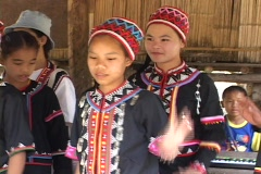 Thailand: girls from an ethnic minority village sing traditional song - stock footage
