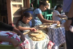 Honduras: Young girl sells pita bread in market Stock Footage