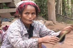 Laos: Ethnic minority woman in remote village Stock Footage