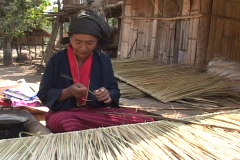 Thailand: Woman makes Bamboo slats Stock Footage