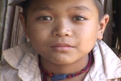 Thailand: Boy of an ethnic minority people near Chiang Mai - stock footage