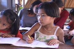 Thailand: Ethnic minority girl in remote village school Stock Footage