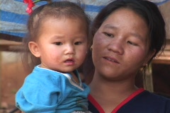 Thailand: Faces of Ethnic minority: Mother and Baby - stock footage
