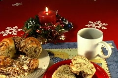 Cinnamon rolls, coffee and a lighted candle - stock footage