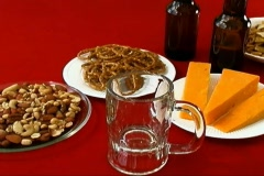 Beer, pretzels, nuts, snack food and cheese Stock Footage