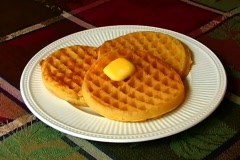 Butter melting on hot waffles Stock Footage