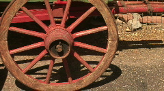 Old Red Wagon Wheel on Rustic Antique Covered Wagon Stock Footage