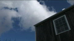 Clouds and a Building (Part 2 of 2) Stock Footage
