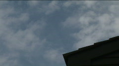Clouds and Corner of Roof (Part 2 of 4) Stock Footage