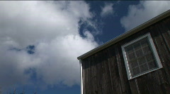 Clouds and a Building (Part 1 of 2) Stock Footage