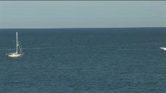 Sailboat and speedboat Stock Footage
