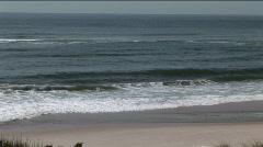 Man walking along beach Stock Footage