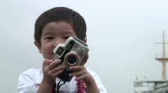 Child with camera - stock footage