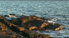 Sunset beach and rocks Stock Footage