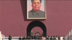 Painting of Chairman Mao and Tourists Enter the Forbidden City in Beijing, China - stock footage