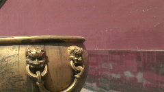 Lion Head Detail on Chinese Pot Stock Footage