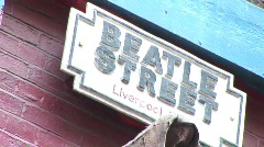 Pull out to Wide of Beatles St Sign Liverpool (Liv002) Stock Footage