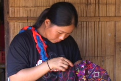 Thailand: Woman from ethnic group works on craft Stock Footage