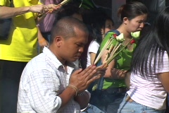 Thailand: Worshipers pray at Buddhist Temple  Stock Footage