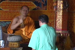 Thailand: Man recieves blessing from Buddhist monk Stock Footage