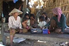 Cambodia: Poor villagers listen to radio program Stock Footage