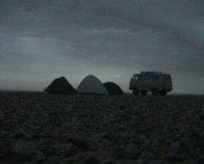 Mongolia - tents and car on the Gobi desert in storm Stock Footage