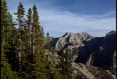 Pan of mountains above valley Stock Footage