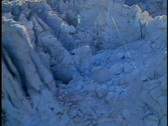 Fly up heavily crevassed and melting glacier 2 Stock Footage